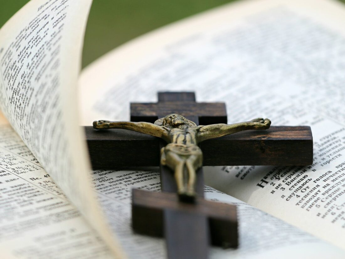 crucifix on top of bible